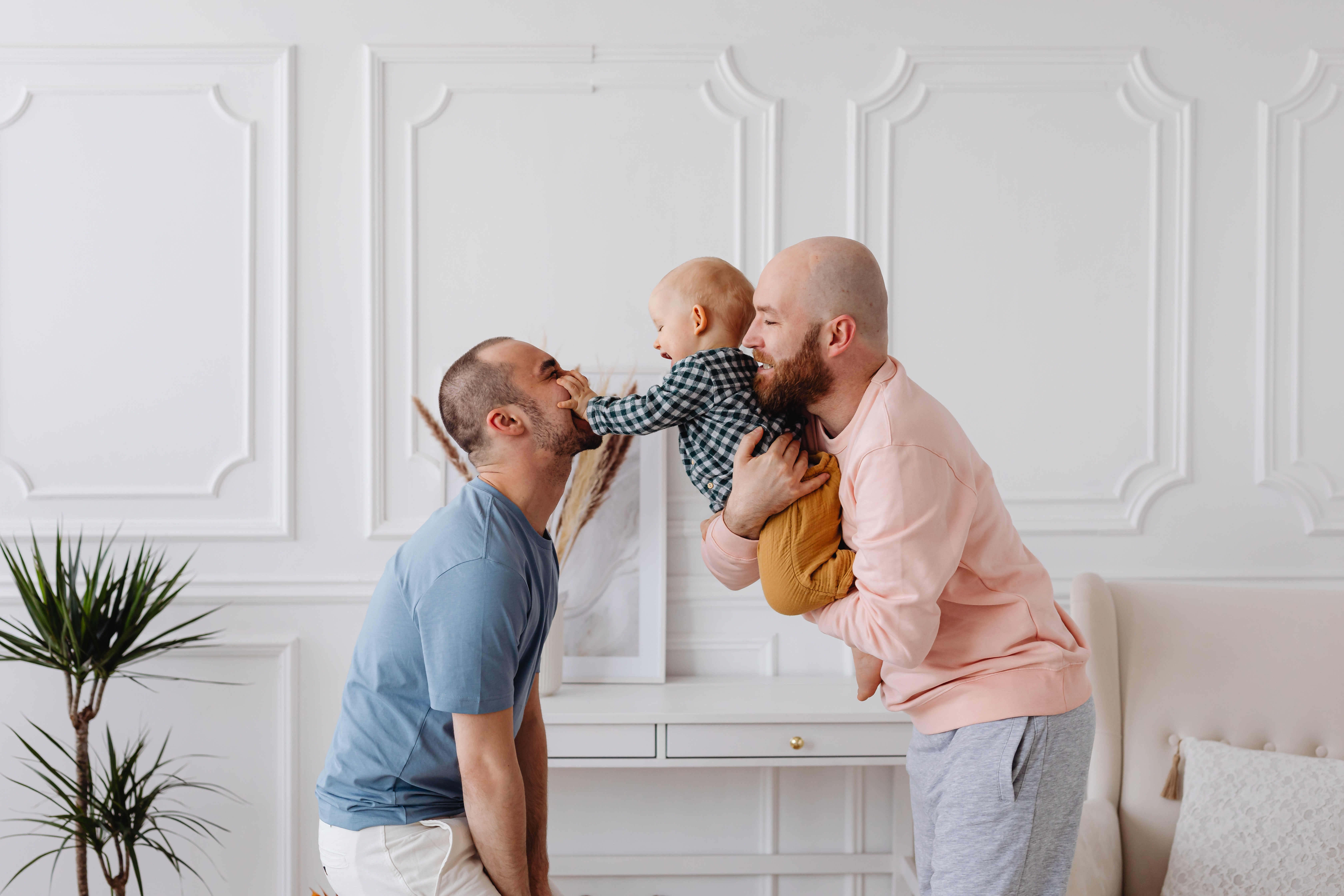 Image of a same sex couple with their baby (photo by karolina-grabowska on Pexels